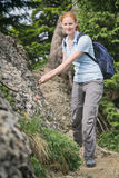 Woman Hiking on a Narrow Path Royalty Free Stock Image
