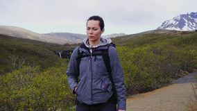 Woman hiking in National park ,Iceland. Woman hiking in National park stock video footage