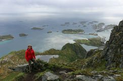 Woman hiking near Henningsvaer on a rainy day Royalty Free Stock Images