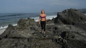 Woman hiking by the Ocean stock video