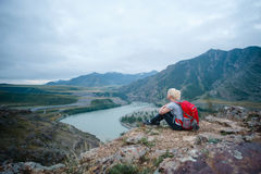 Woman hiking outdoors. Eco Tourism. Royalty Free Stock Photography