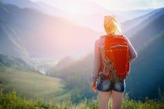 Woman hiking outdoors. Eco Tourism. Woman hiking outdoors. Eco Tourism stock photo
