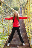 Woman hiking with outstretched to the sides hands Stock Image