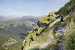 Woman on hiking path. Woman walking on hiking path in swiss mountains Royalty Free Stock Photography