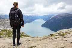 Woman hiking at the pulpit rock in lysefjorden Norway Stock Photos