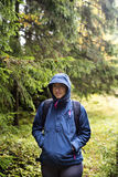 Woman hiking in rainy forest Royalty Free Stock Image