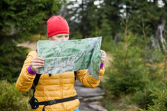 Woman hiking and reading map Royalty Free Stock Images