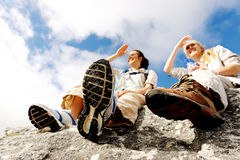 Woman hiking rest. Two women take a break from trekking and rest on a rock outdoors stock photos