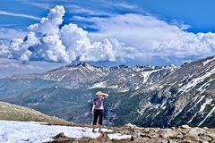 Woman hiking in Rocky Mountains National Park. Stock Photography