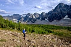 Woman hiking in rocky mountains. Royalty Free Stock Photography