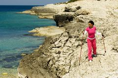 Woman hiking by the sea Royalty Free Stock Photos