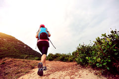 Woman hiking on seaside mountain trail Stock Image