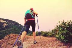 Woman hiking on seaside mountain trail Stock Photos
