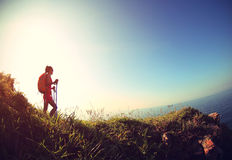Woman hiking on seaside mountain trail Royalty Free Stock Images