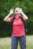 Woman hiking and shouting out Royalty Free Stock Photo