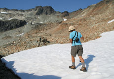 Woman Hiking on Snow in Summer. Filipino woman hiking on the south side of Mount Callaghan. British Columbia. Canada Stock Image