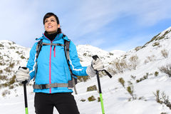 Woman hiking on snowy mountain Stock Image