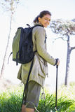 Woman with hiking sticks stock image
