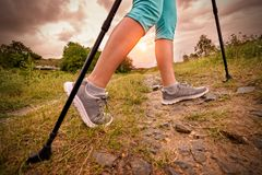 Woman hiking with sticks. Outdoor Active and healthy lifestyle concept Stock Images