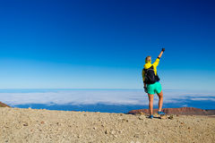Woman hiking success climber on mountain top Royalty Free Stock Photos