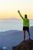 Woman hiking success in mountains sunset Stock Photography