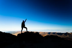 Woman hiking success silhouette on mountain top. Woman successful hiking climbing silhouette in mountains, motivation and inspiration landscape on island and Stock Images