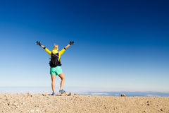 Woman hiking success silhouette in mountain top Stock Photos
