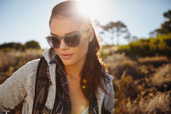 Woman hiking in a sunlit nature reserve Stock Photography