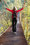 Woman hiking in suspension bridge Royalty Free Stock Photo