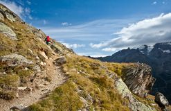 Woman hiking in swiss alps Stock Photo