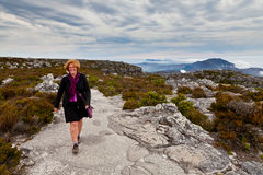 Woman hiking on the table mountain stock image