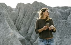 Woman hiking to the top of mountain in nature royalty free stock photo