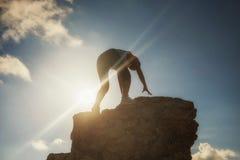 woman hiking to top of mountain at sunset Stock Photos