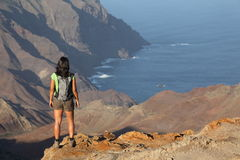 Woman hiking on top volcanic craters on St Helena Stock Image