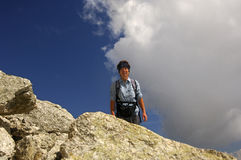 Woman on a hiking tour in the alps Stock Photos