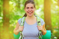 Woman hiking tourist with backpack outdoors portrait Royalty Free Stock Photos