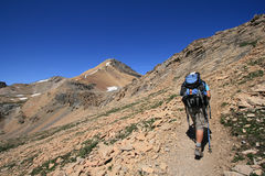 Woman Hiking Towards Cirque Peak Stock Photo