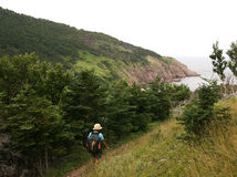 Woman Hiking Towards Cove Royalty Free Stock Images