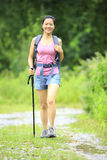 Woman hiking on trail Royalty Free Stock Photos