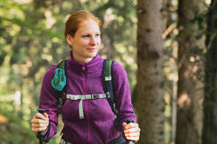 Woman Hiking or Trekking in a Forest Stock Images
