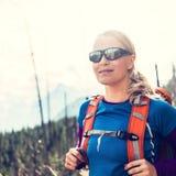 Woman hiking trekking in mountains Stock Image