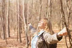 Woman is hiking and trekking outside on a hill. Tourism, vacation and fitness activity concept. Woman is hiking and trekking outside on a hill. Outdoor tourism royalty free stock photography