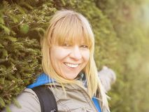 Woman is hiking and trekking outside on a hill. Tourism, vacation and fitness activity concept. Woman is hiking and trekking outside on a hill. Outdoor tourism royalty free stock photo