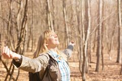 Woman is hiking and trekking outside on a hill. Tourism, vacation and fitness activity concept. Woman is hiking and trekking outside on a hill. Outdoor tourism stock images