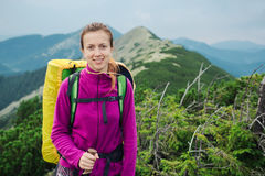 Woman hiking with trekking sticks and backpack Royalty Free Stock Photos