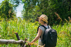 Woman hiking in tropical field Stock Images