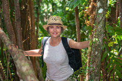 Woman hiking in tropical forest Royalty Free Stock Image