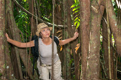 Woman hiking in tropical forest Stock Photos