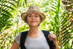 Woman hiking in tropical forest Royalty Free Stock Photography
