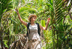 Woman hiking in tropical forest Royalty Free Stock Photos